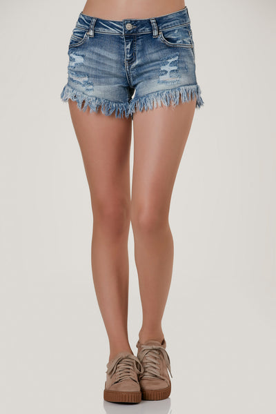 Basic low rise denim shorts with vintage style faded wash. Distressing throughout with heavily frayed raw hem finish.