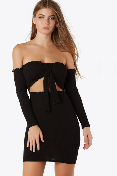 Night out bodycon off shoulder mini dress with tie front closure. Ruching accents along dress trim.