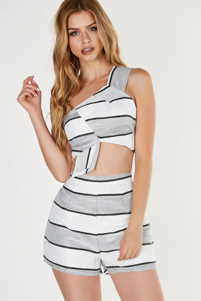 Chic one shoulder crop top with stripe patterns throughout. Fully lined with back zip closure. Comes in a set with matching bottoms sold separately.