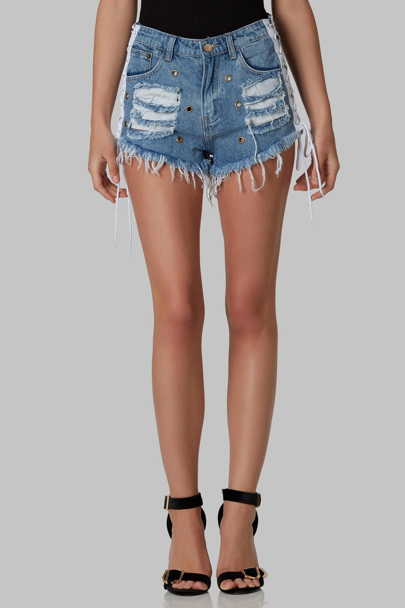 A stylish pair of denim shorts perfect for the spring. These shorts have distressed rips on the front and back, with lace up detailing on each side. Has single zipper at bottom for closure.