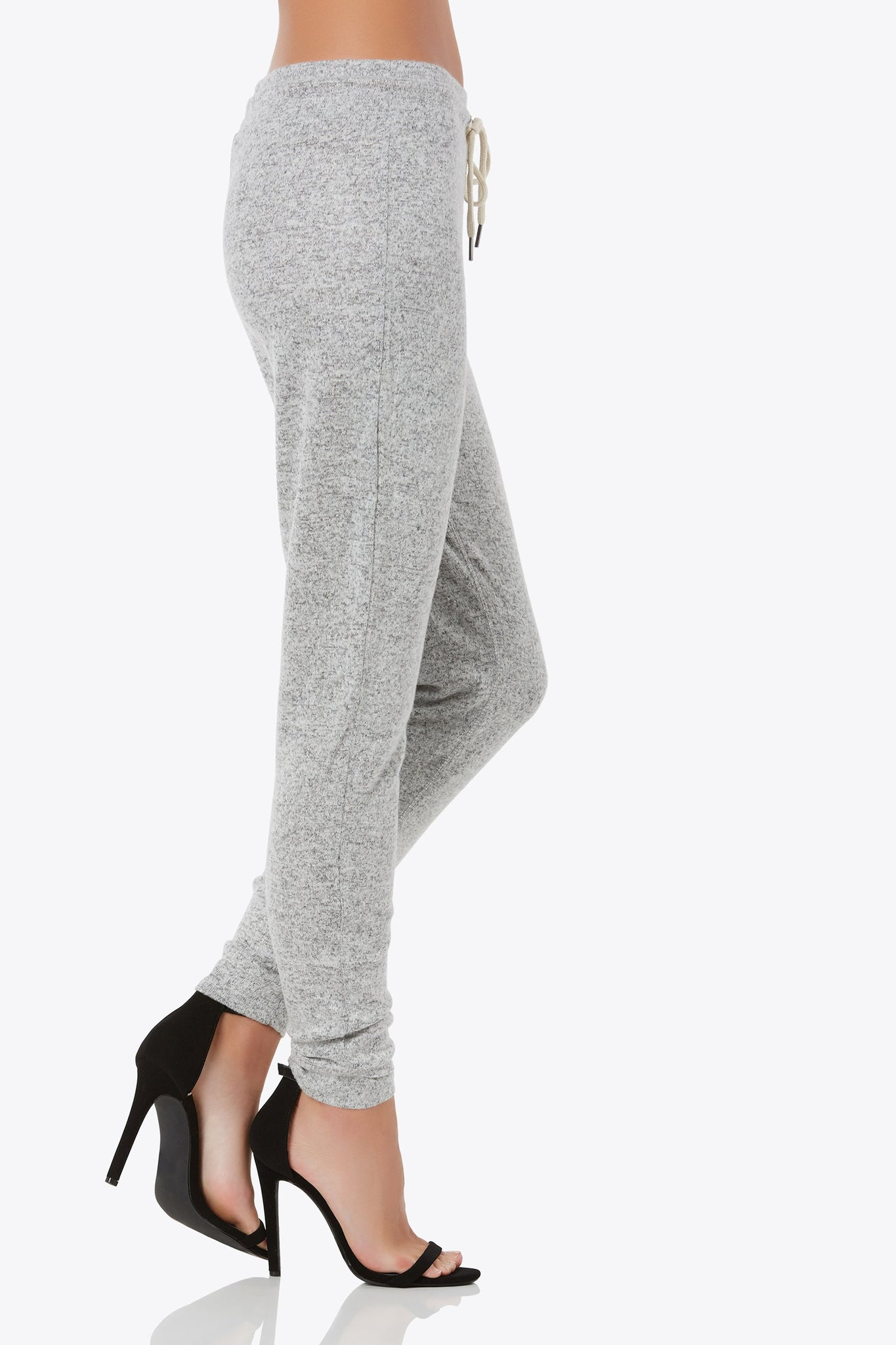 Relax all day in this soft knit drawstring joggers with elastic waistband and contrast drawstrings.