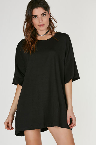Oversized round neck T-shirt dress with drop shoulders and flirty A-line hem. Boxy sleeves and double edges all around.