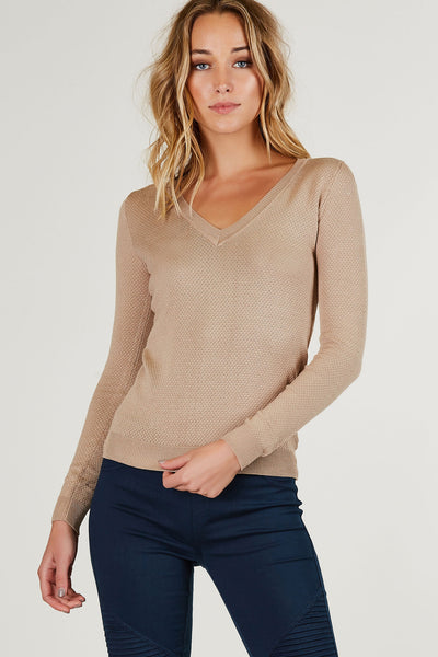 V-neck long sleeve knitted top with comfy snug fit. Straight ribbed hem all around.
