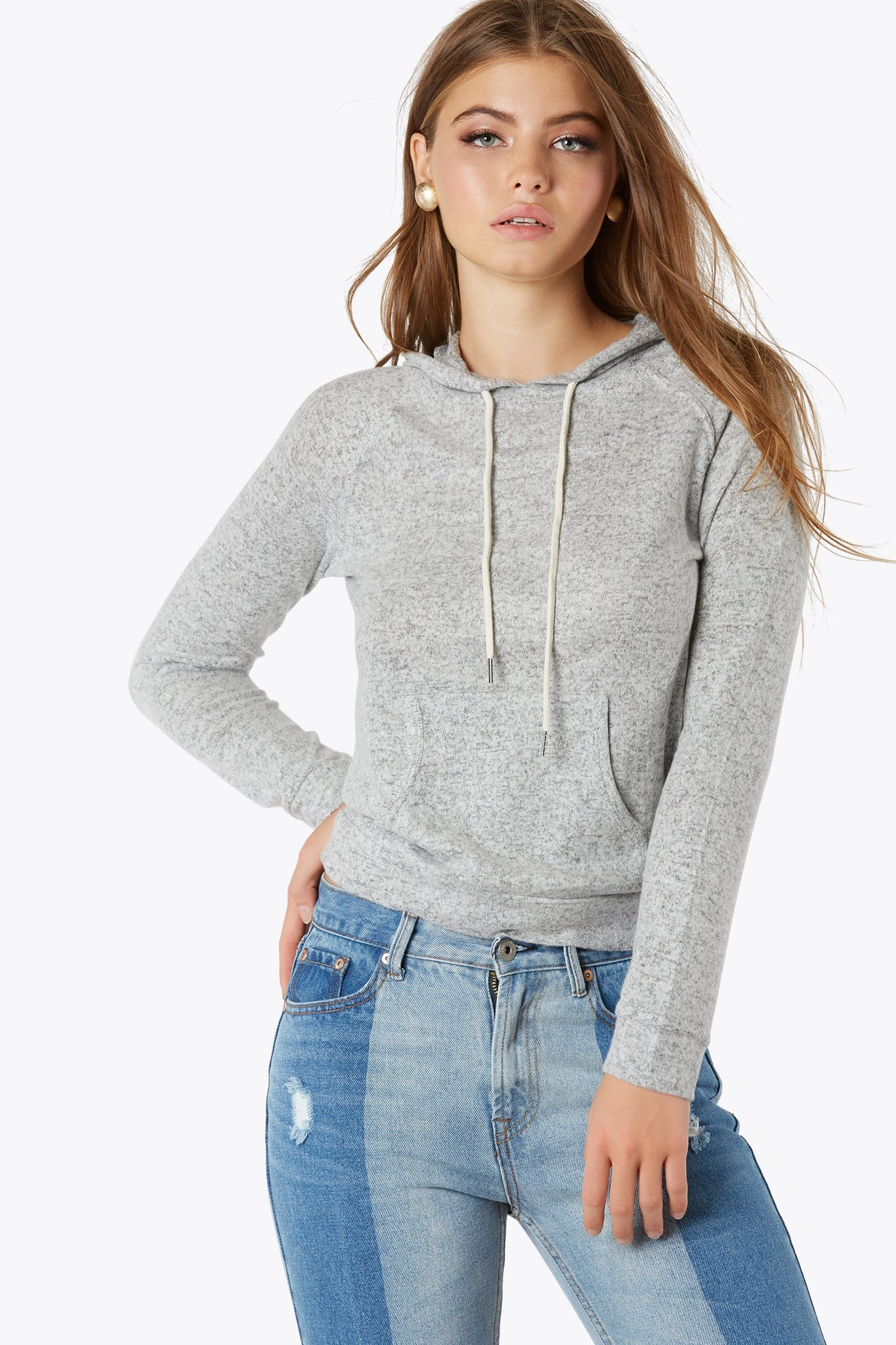 Soft, light-weight long sleeve hoodie with front pocket. Features contrast drawstrings.