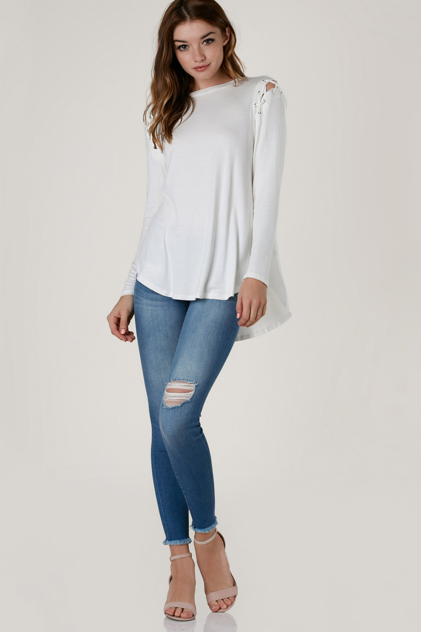 Low rise skinny jeans with comfortable stretchy fit. Soft distressing with frayed raw hem finish.