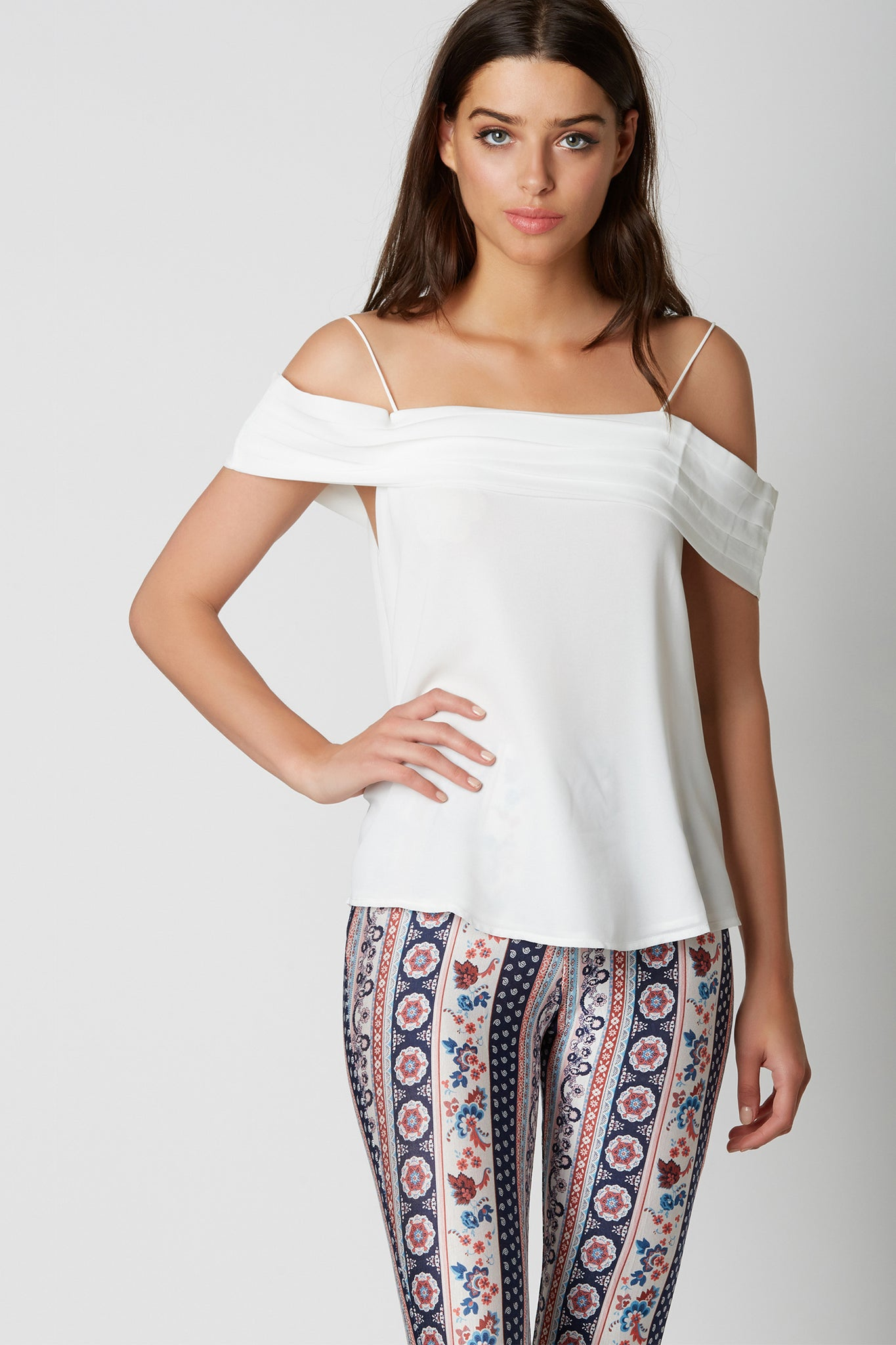Chic cold shoulder chiffon top with pleated design at top with straight neckline. Fully lined with relaxed fit.
