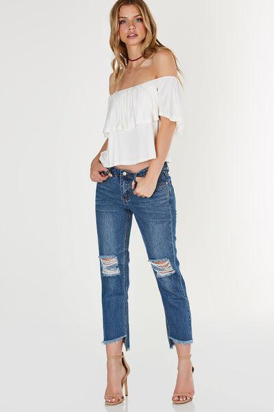Soft, lightweight off shoulder top with tier design. Flowy fit with straight hem all around.