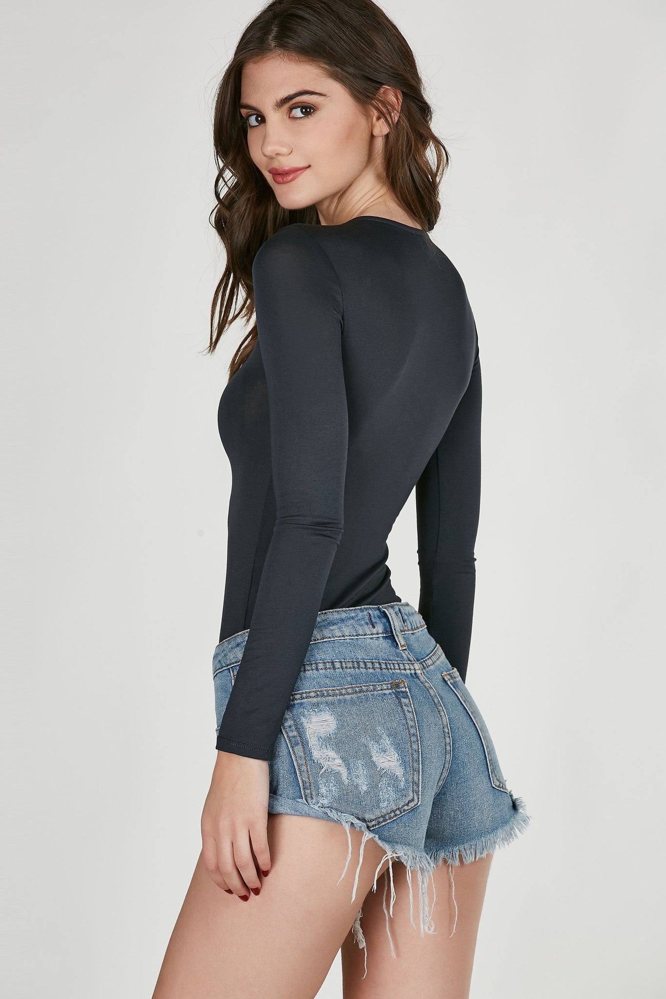 High neck long sleeve bodysuit with trendy lace up design at top. Slinky material with comfortable stretchy fit. Cheeky cut with snap button closure.