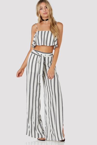 Sleeveless lined crop top with stripe patterns throughout. Relaxed fit with back zip closure.