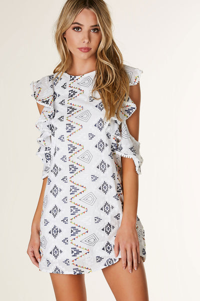 Chic round neck mini dress with colorful aztec print throughout. Cold shoulder cut out with flirty ruffled sleeves. Boxy fit with cut out in back and ties for closure.