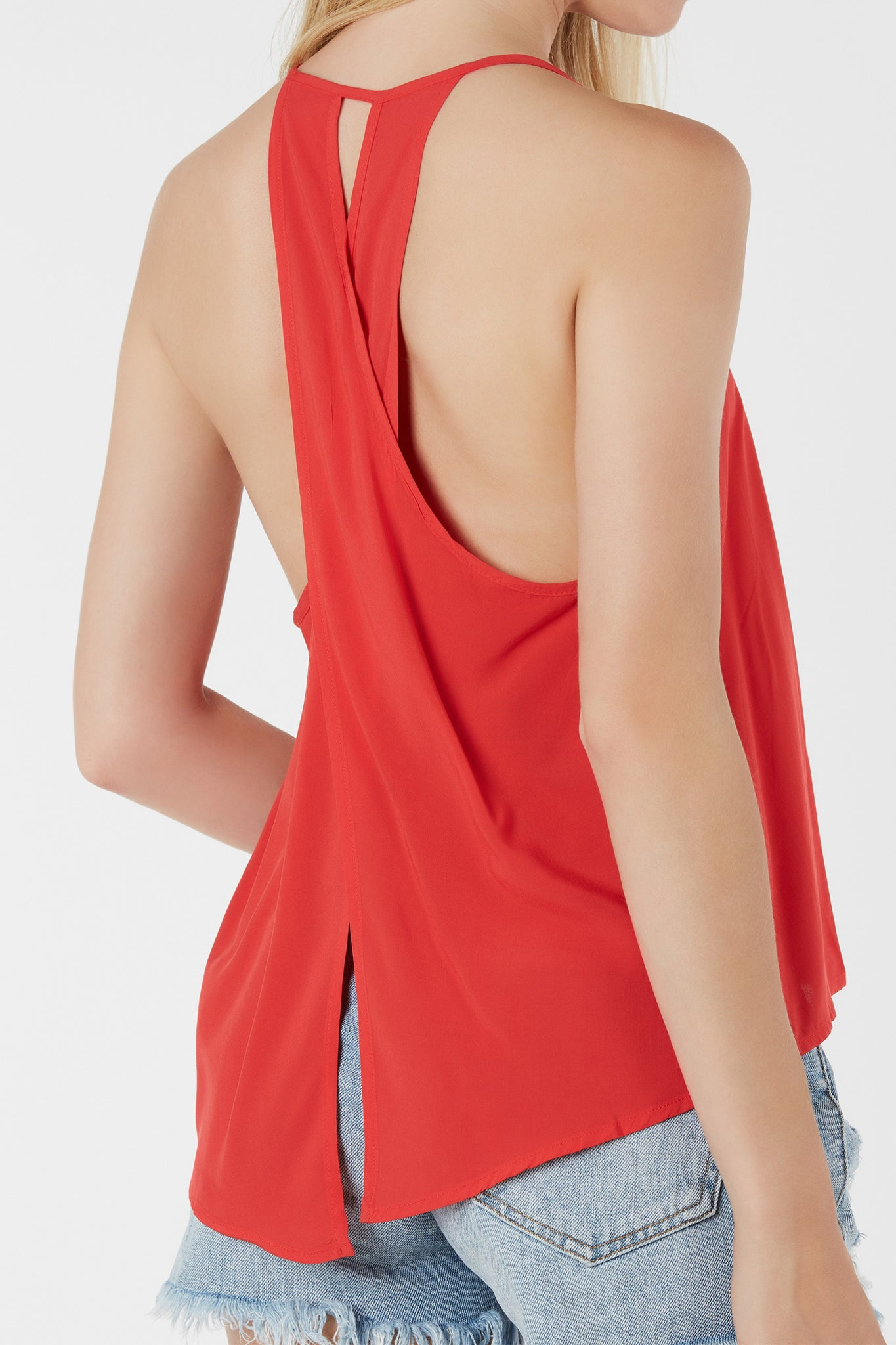 Lightweight high neck cami with tulip back design. Keyhold cut out with flowy fit.