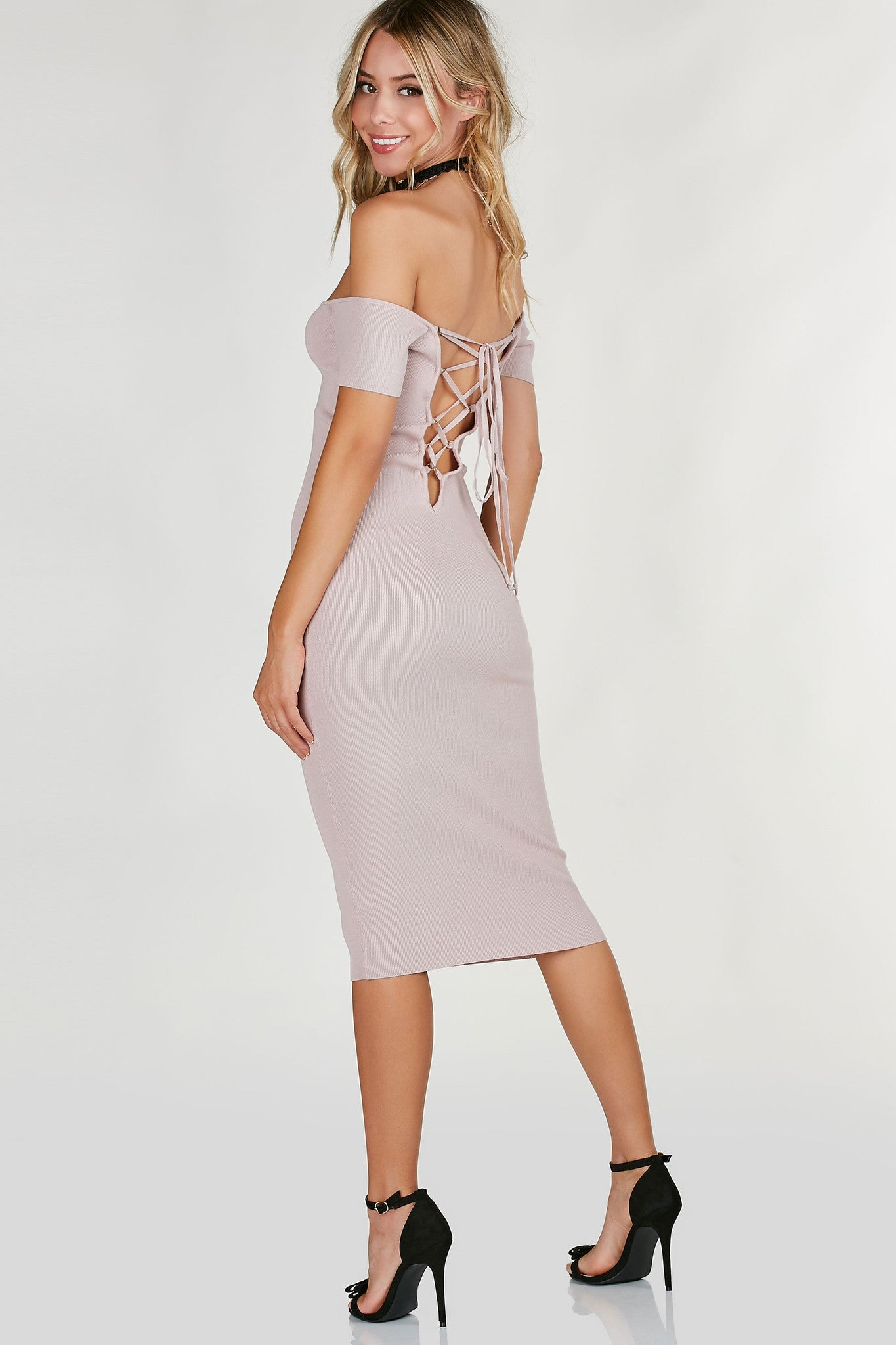 Ribbed boat neck midi dress with flattering fit all around. Sexy cut out back with lace up closure.