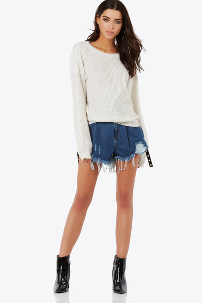 Cozy oversized knit sweatere with rounded neckline. Cut out back with criss-cross strap detailing.