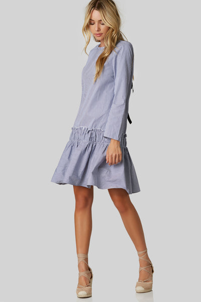 Crew neck long sleeve tunic dress with pin stripe patterns throughout. Boxy fit with ruffle design at hem. Cut out back with contrast lace up design for fit and closure.