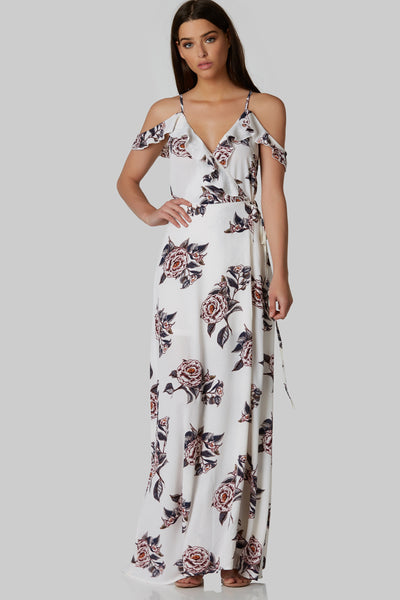 Gorgeous ruffle and tie detailed  V-neck maxi dress with open back. Fully lined with floral print throughout and tie up back closure.