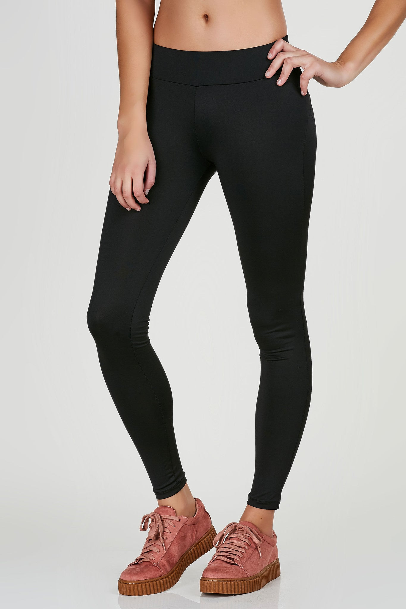 Mid rise active leggings with stretchy fit. Arched seamwork at back for a push up effect.