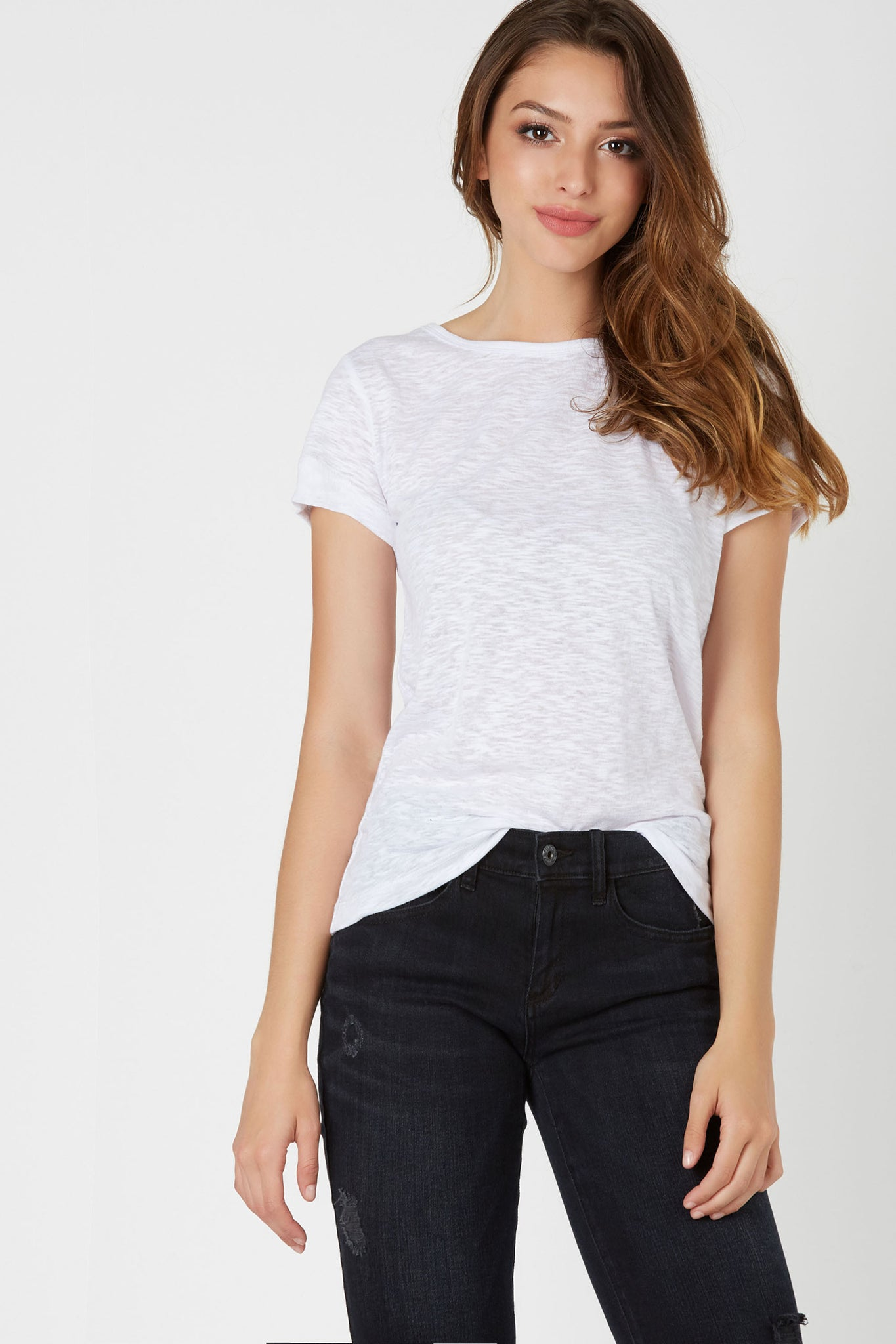 Basic crew neck T-shirt with relaxed fit. Cut out back with lace up design.