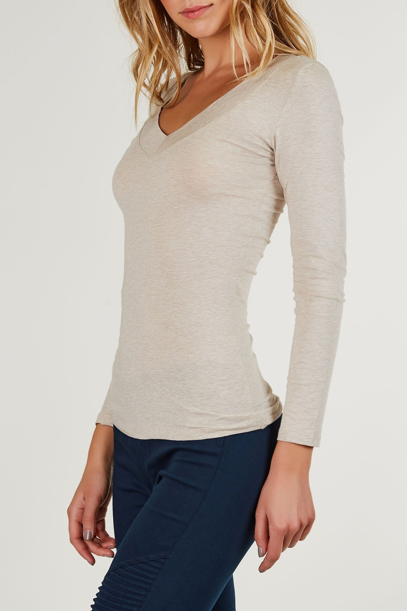 Long sleeve V-neck top with longline hem. Lightweight material with comfortable snug fit.