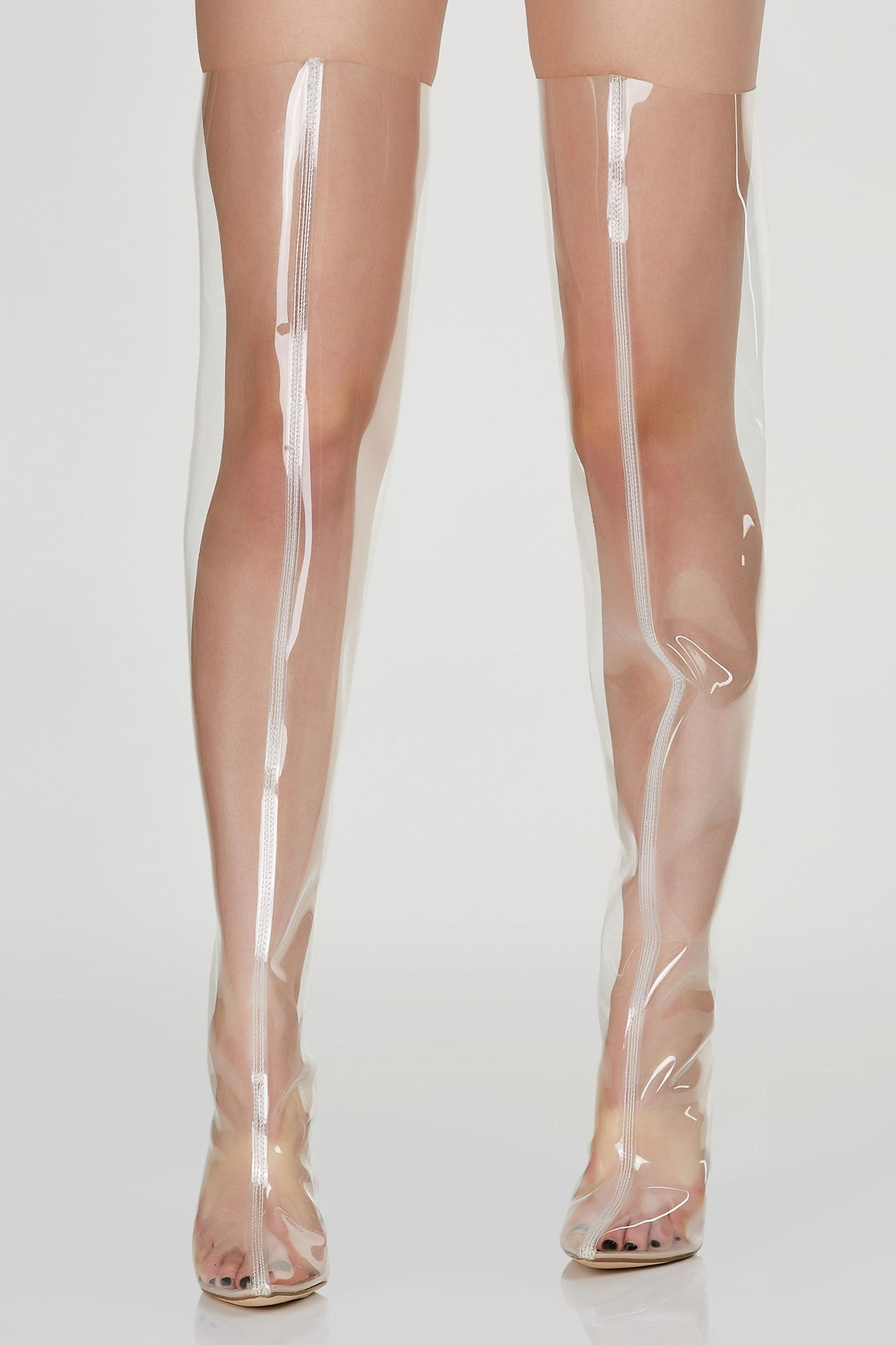 See through thigh high boots with back zip closure. Pointed toe with clear block heels.