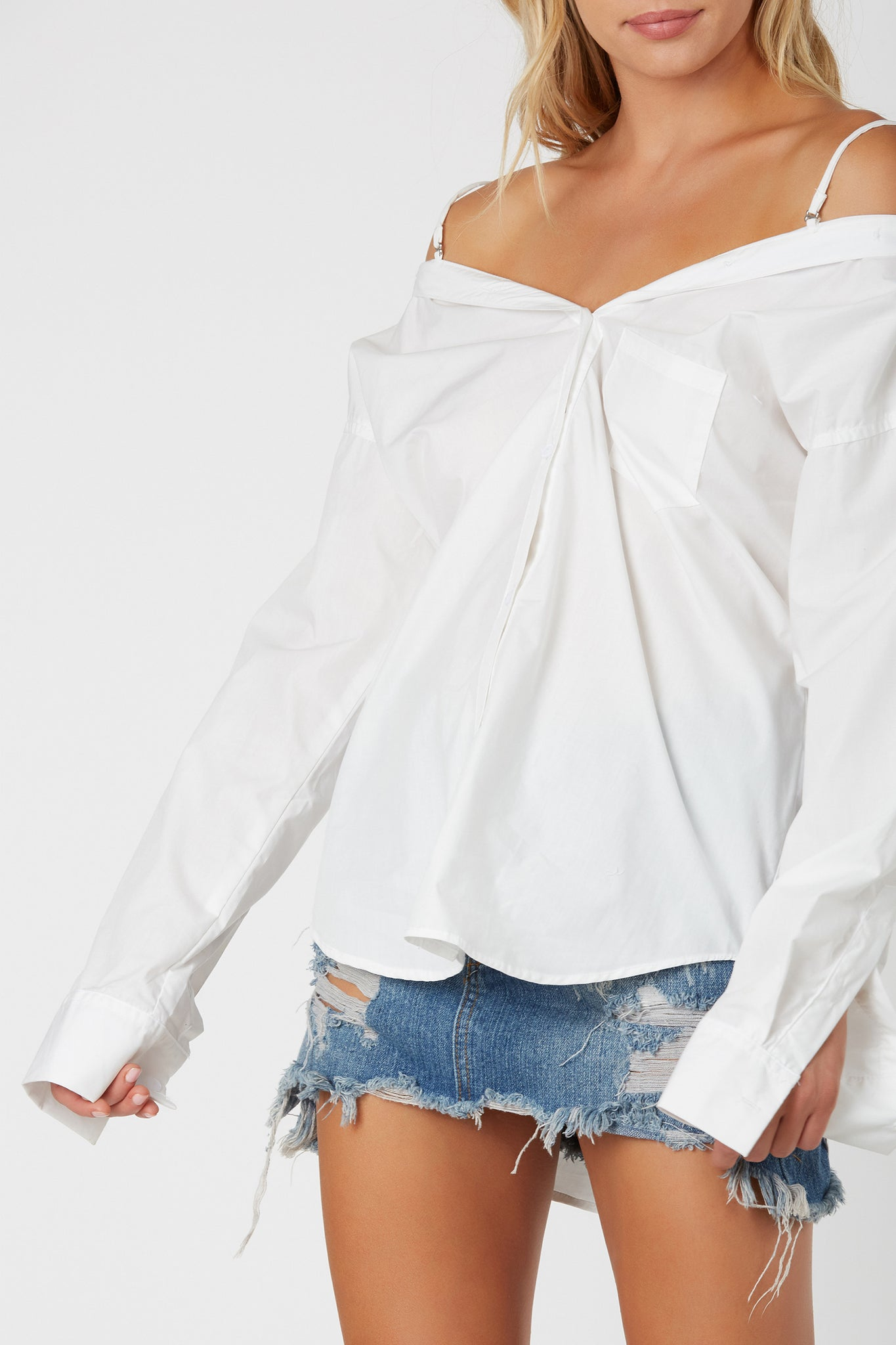 Flattering oversized button down with trendy off shoulder design. Cold shoulder spaghetti straps with oversized fit.