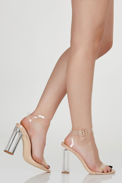 Chic open toe heels with clear strap design. Adjustable buckle for fit and closure with trendy block heels.