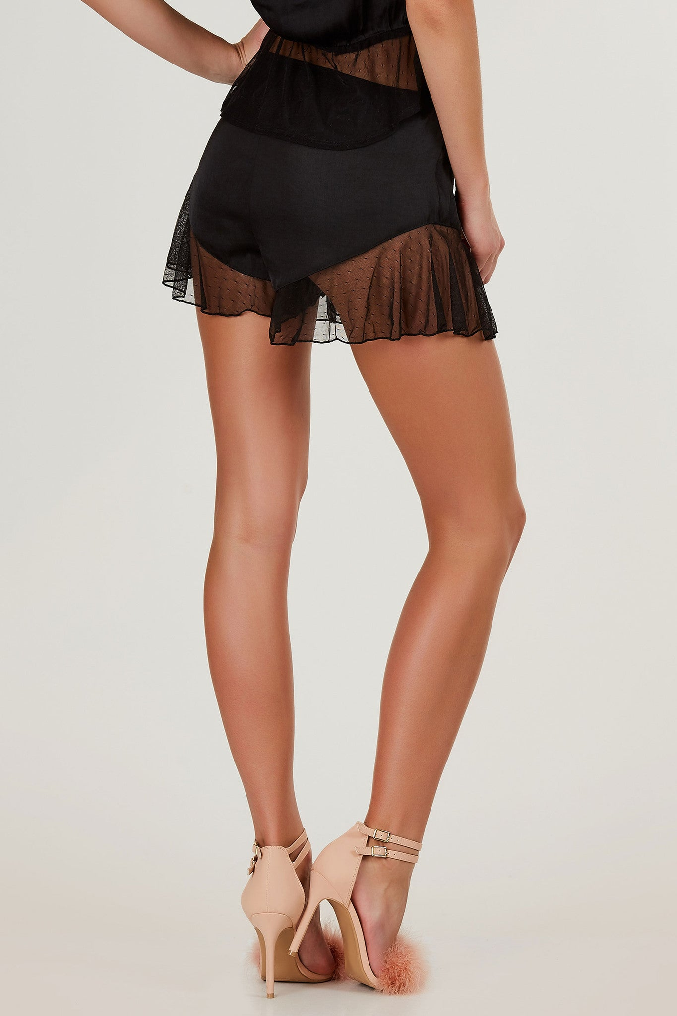 Smooth lightweight slip on shorts with mesh ruffle trim throughout. Elasticized waistband with flowy fit.
