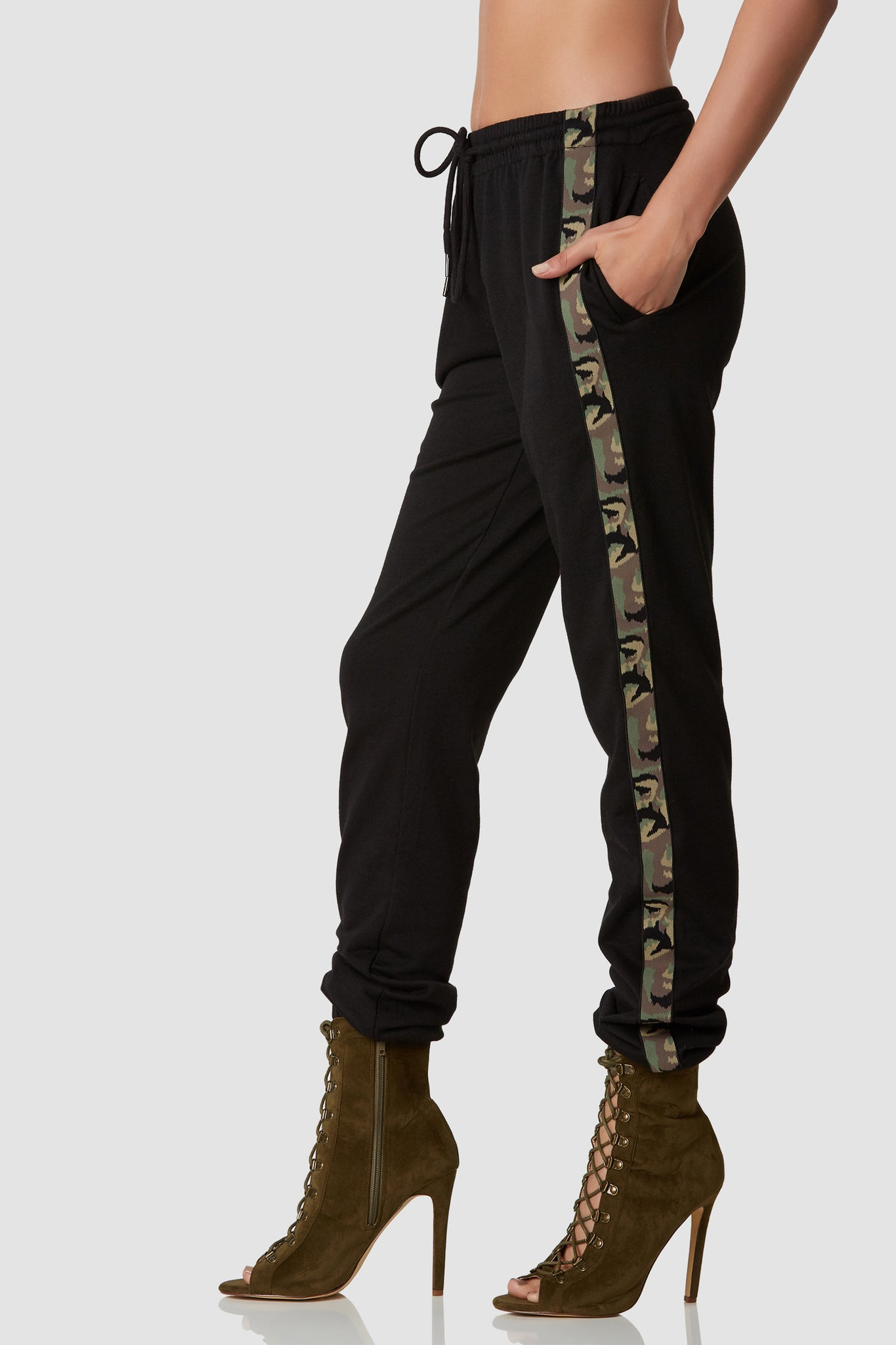 Casual relaxed fit joggers with comfortable drawstring waistband and trendy camo panel on each side. Side pockets with elasticized hem finish.