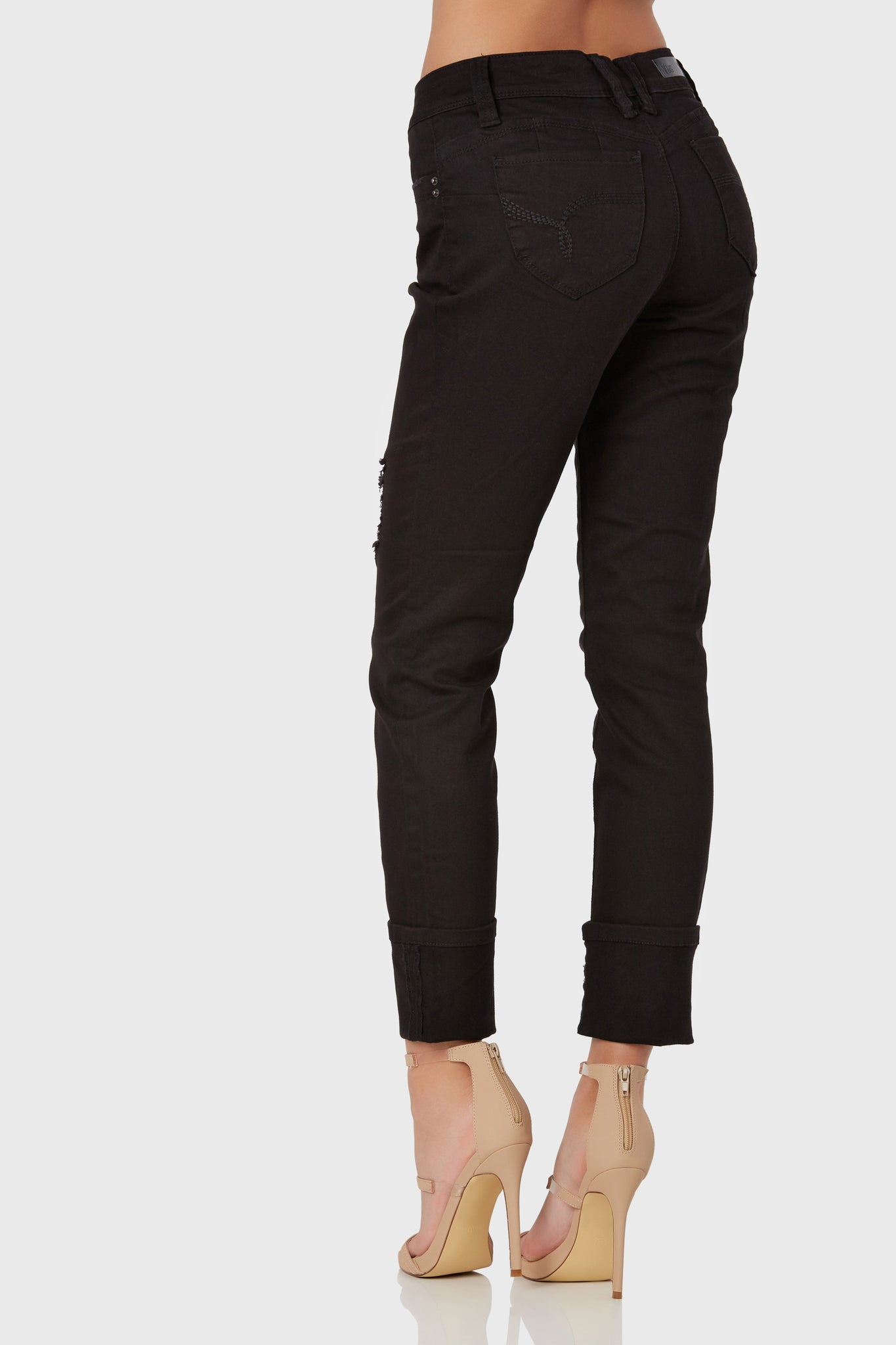 Classic mid rise skinnies with trendy 4 cuff design. Subtle distressing with heartshape seam in back to flatter the bum.