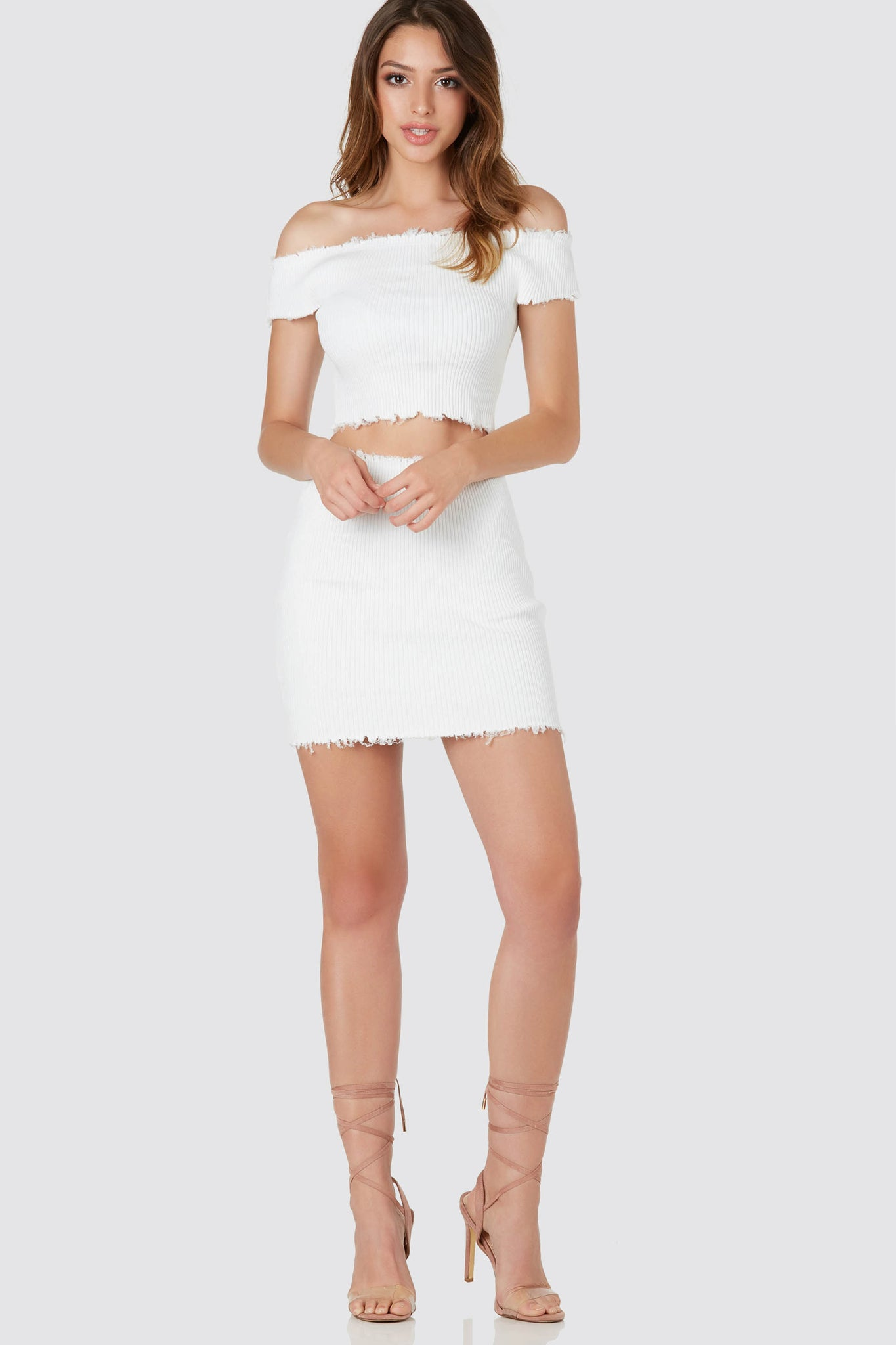 Sassy ribbed skirt with trendy raw hem finish and flattering bodycon fit.