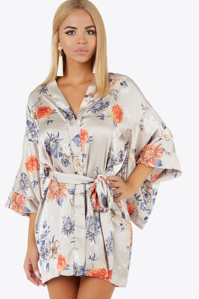 Wrap yourself up in this silk-like kimono sleeve dress. Features hidden buttons down center and adjustable waist tie.