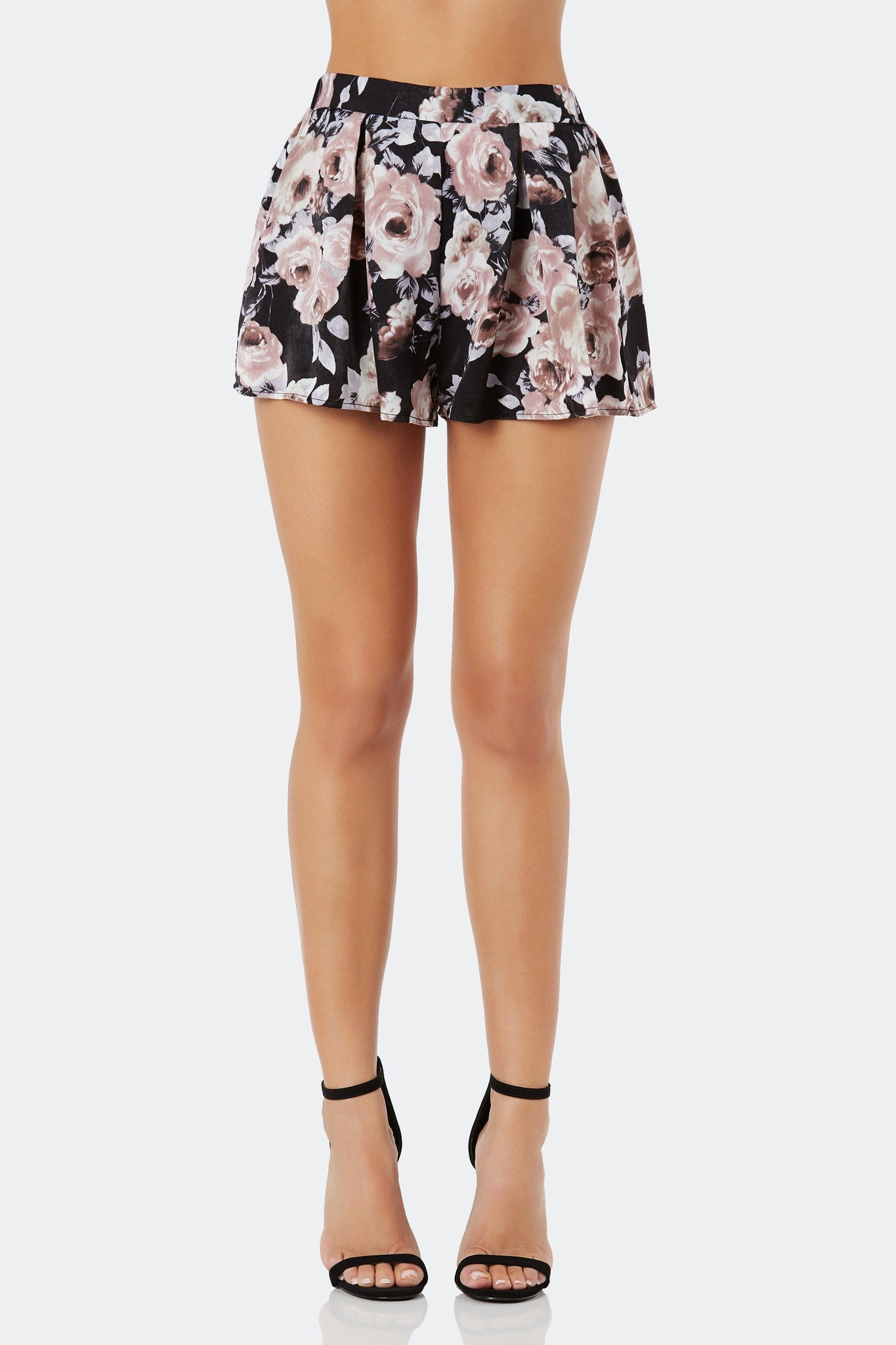 Flirty A-line shorts with smooth satin-like finish. Bold floral print throughout with elasticized waist.