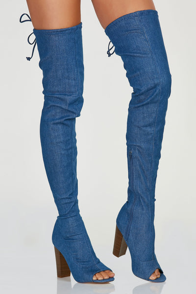 Trendy thigh high boots with peep toe cut out and denim finish all around. Chunky block heels with size zip closure.