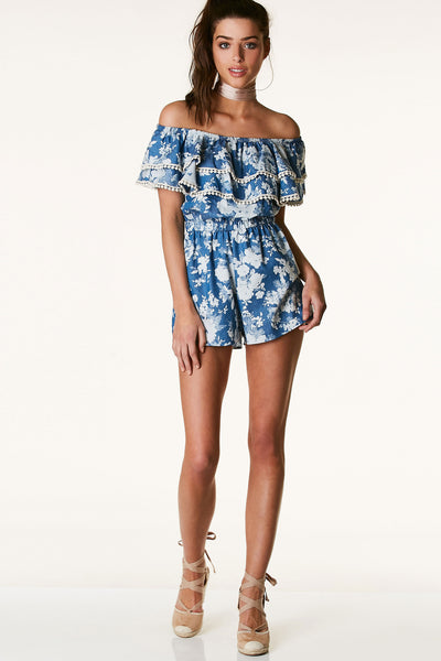 Floral printed off shoulder romper with tiered design. Crochet trim detailing with confortable elasticized waistband.