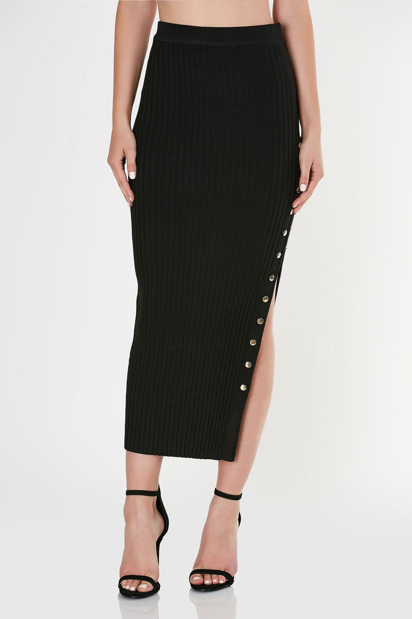 Sexy high rise bodycon skirt made of stretchy ribbed material. Straight hem with gold hardware snap button detailing for a side slit effect. Comes in a set with matching top sold separately.