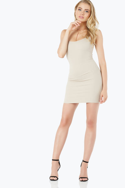 U-neck rib knit bodycon dress double lined for added coverage. Scooped back with straight hem finish.
