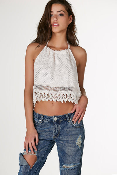 Flirty halter neck crop top with intricate crochet finish. Open back with ties for closure.