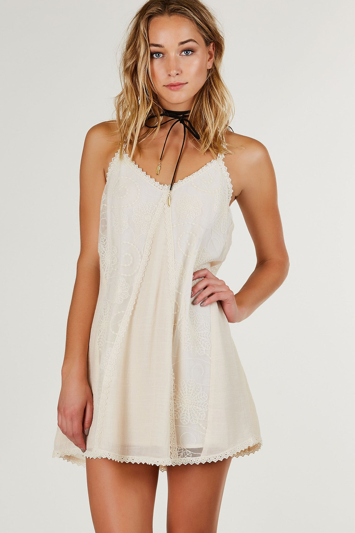 Soft V-neck sleeveless shift dress with intricate lace and crochet detailing throughout. Fully lined with A-line hem.