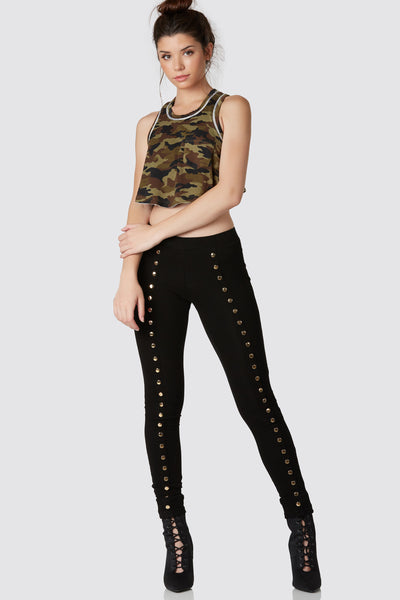 Comfortable sleeveless crop top with bold camo print throughout. Single pocket design with bralette lined underneath.