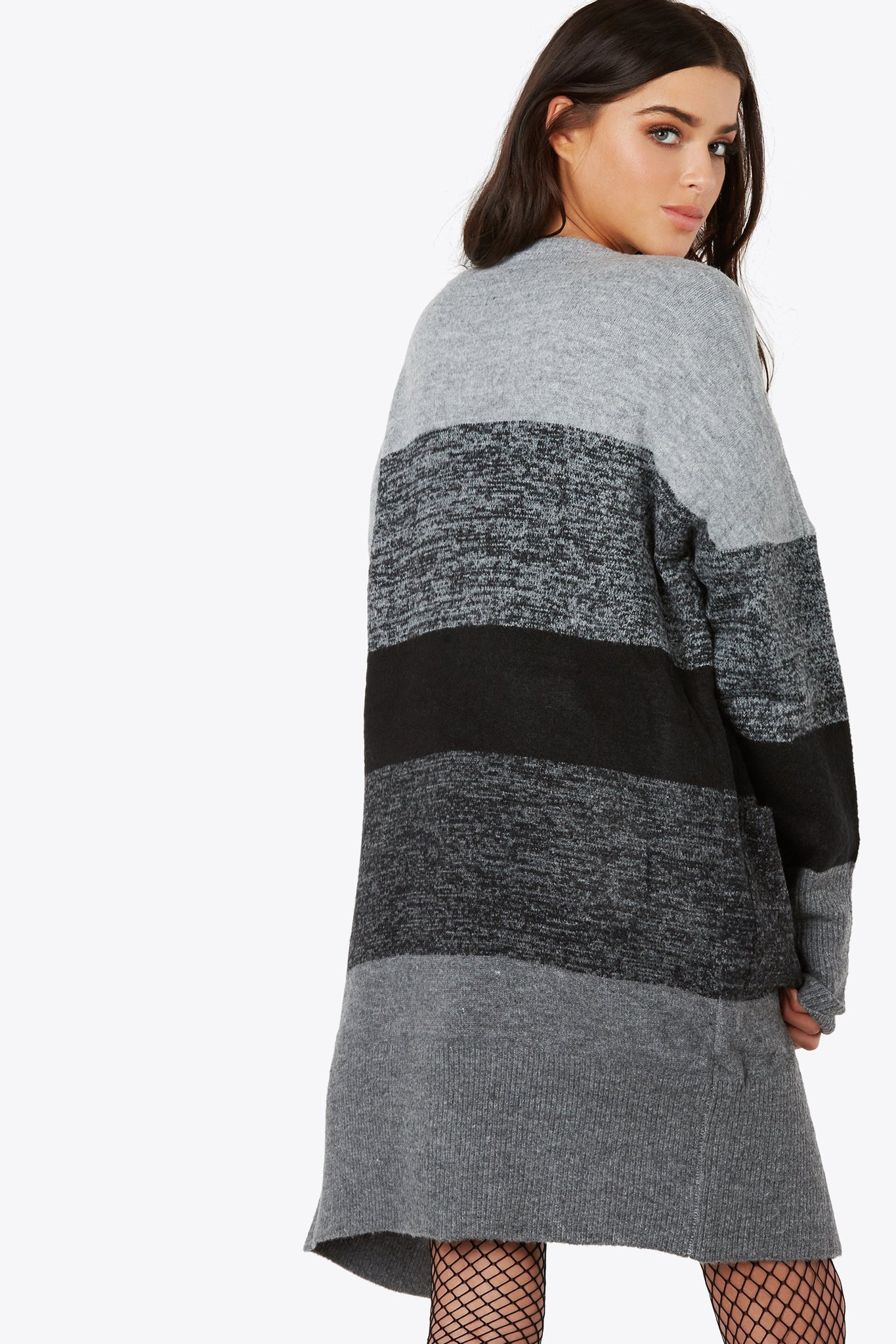 Stay cozy no matter in or outside in the soft knit long sleeve cardigan. Features front hidden pockets.