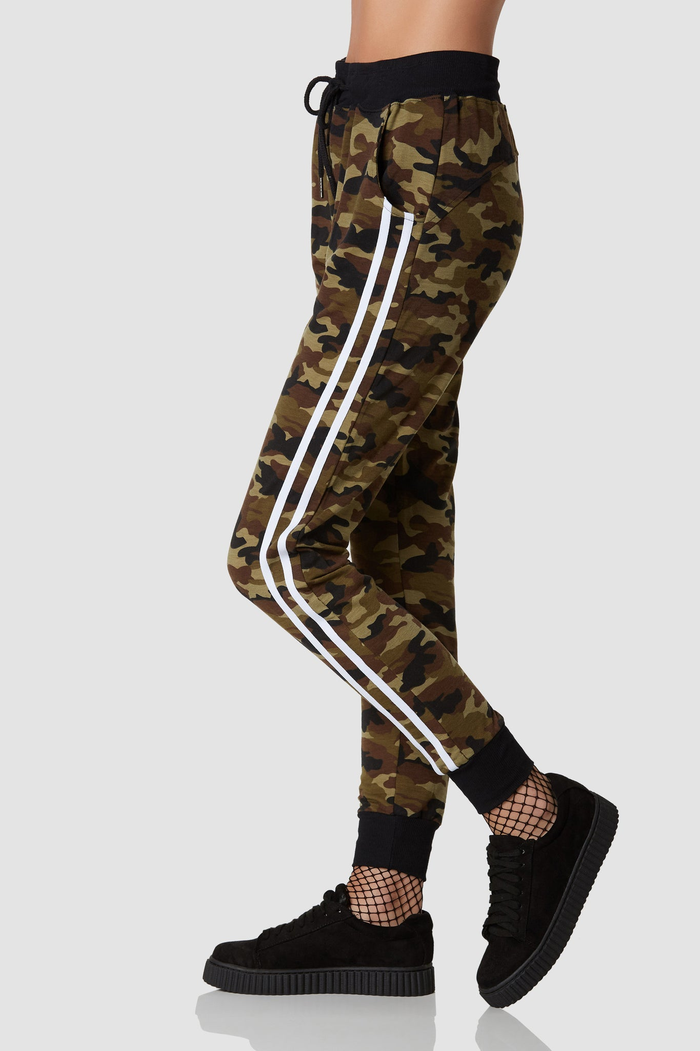 Casual high rise printed joggers with camo print throughout. Drawstring waistband with side pockets and trendy contrast stripes down each side.