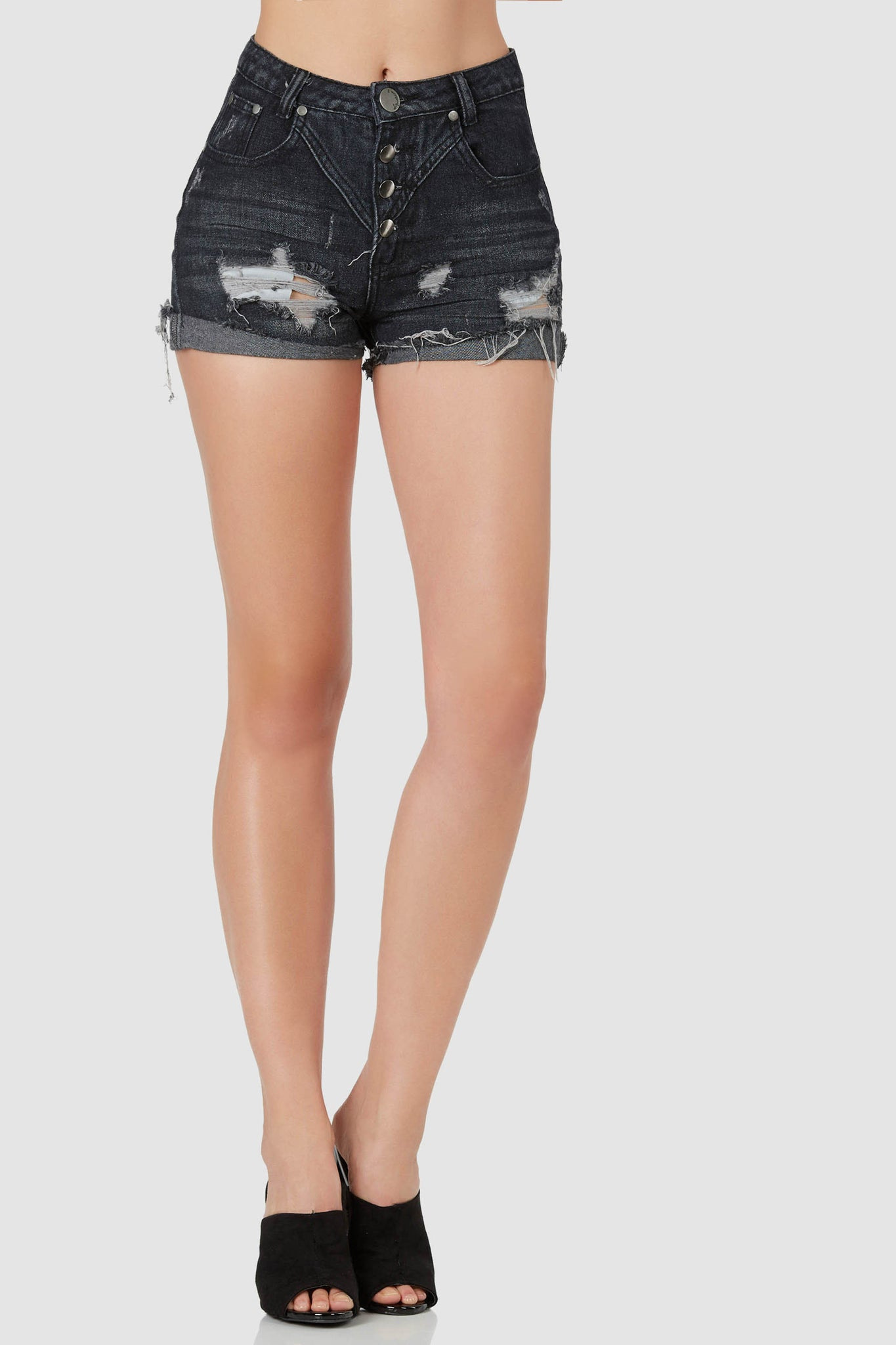 Vintage style high rise denim shorts with slight fade and distressed detailing. Frayed raw hem finish, slightly cuffed for a casual touch.