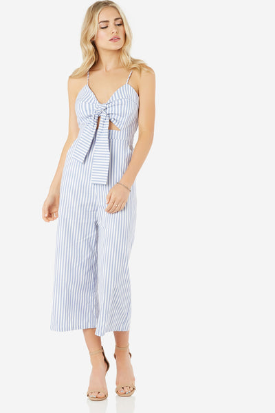 Spaghetti strap jumpsuit with stripe pattern throughout. Center cut out with bold bow detailing. Wide leg fit with back zip closure.