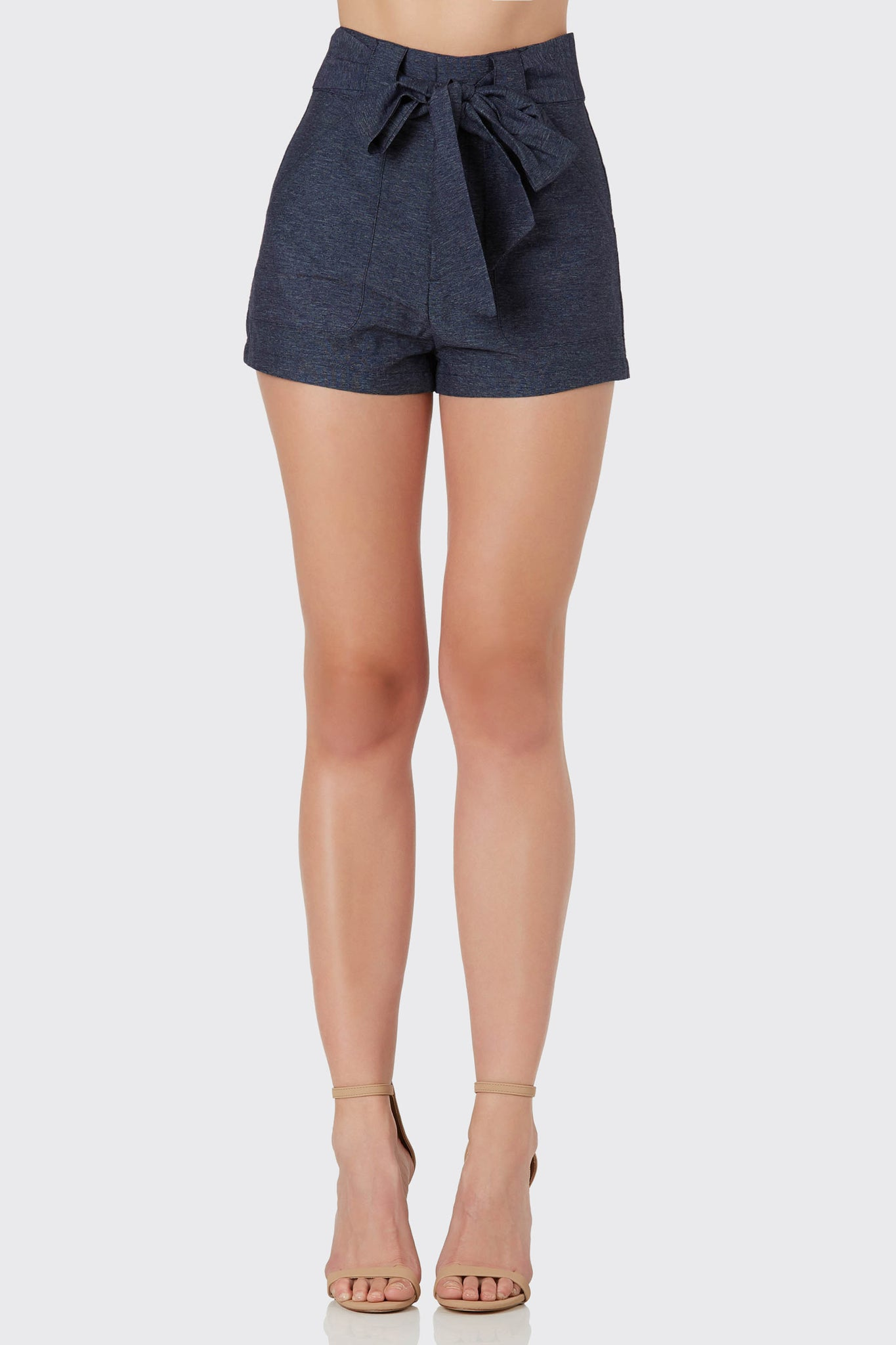Chic high rise shorts with button zip closure and waist tie for added detail.