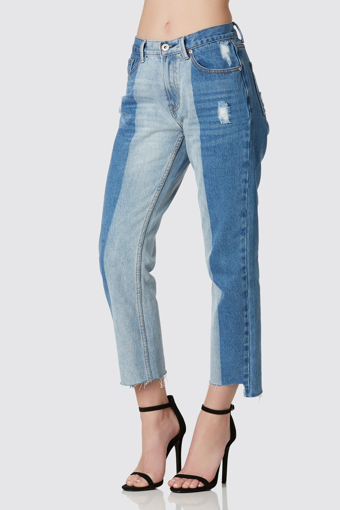 Trendy mom jeans with vintage style two tone effect. Soft distressing with uneven step hem finish.