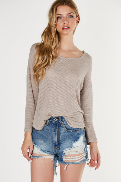 Round neck crochet style knitted top with cropped sleeves. Oversized fit with rounded hi-low hem.
