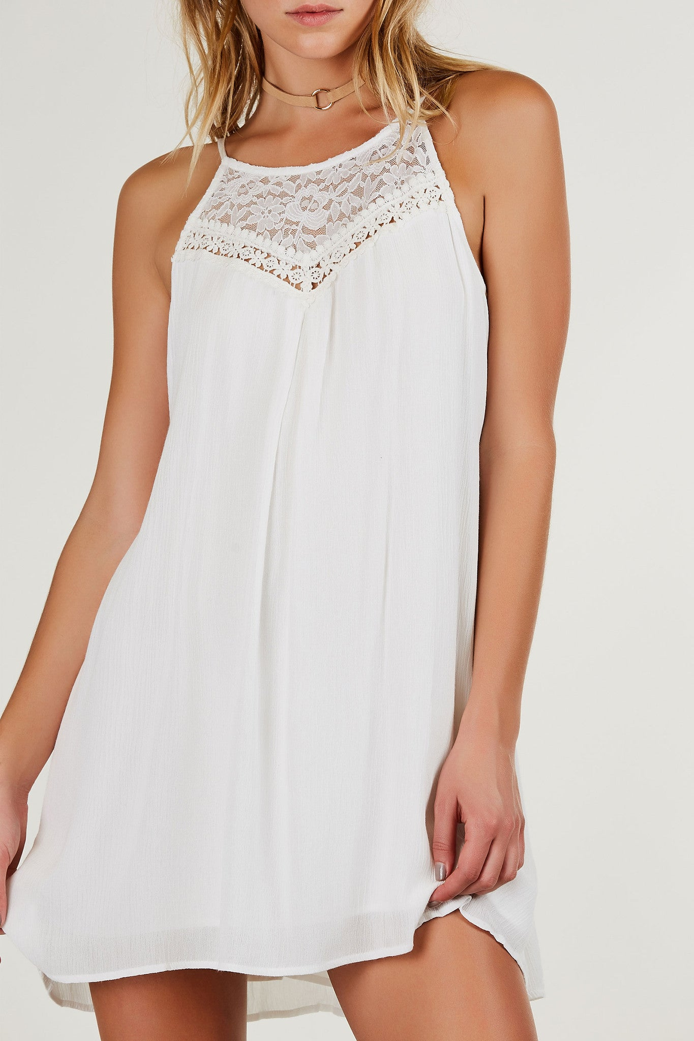 Flowy high neck sleeveless dress with lace panel design and crochet detailing. Cut out back with lace up finish and A-line hem.