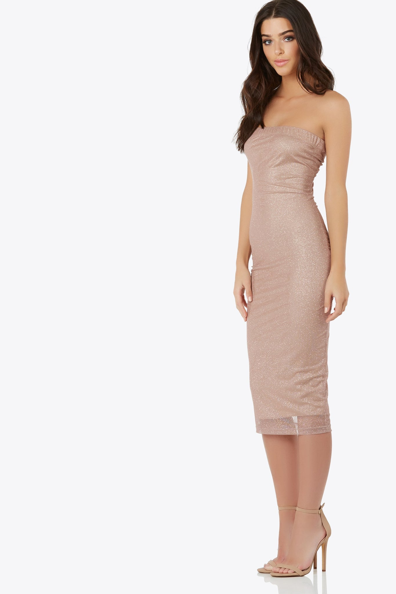 Stay out all night in this sheer strapless midi dress with glitter accents. Fully lined with elastic band on top hem for a comfort fit.