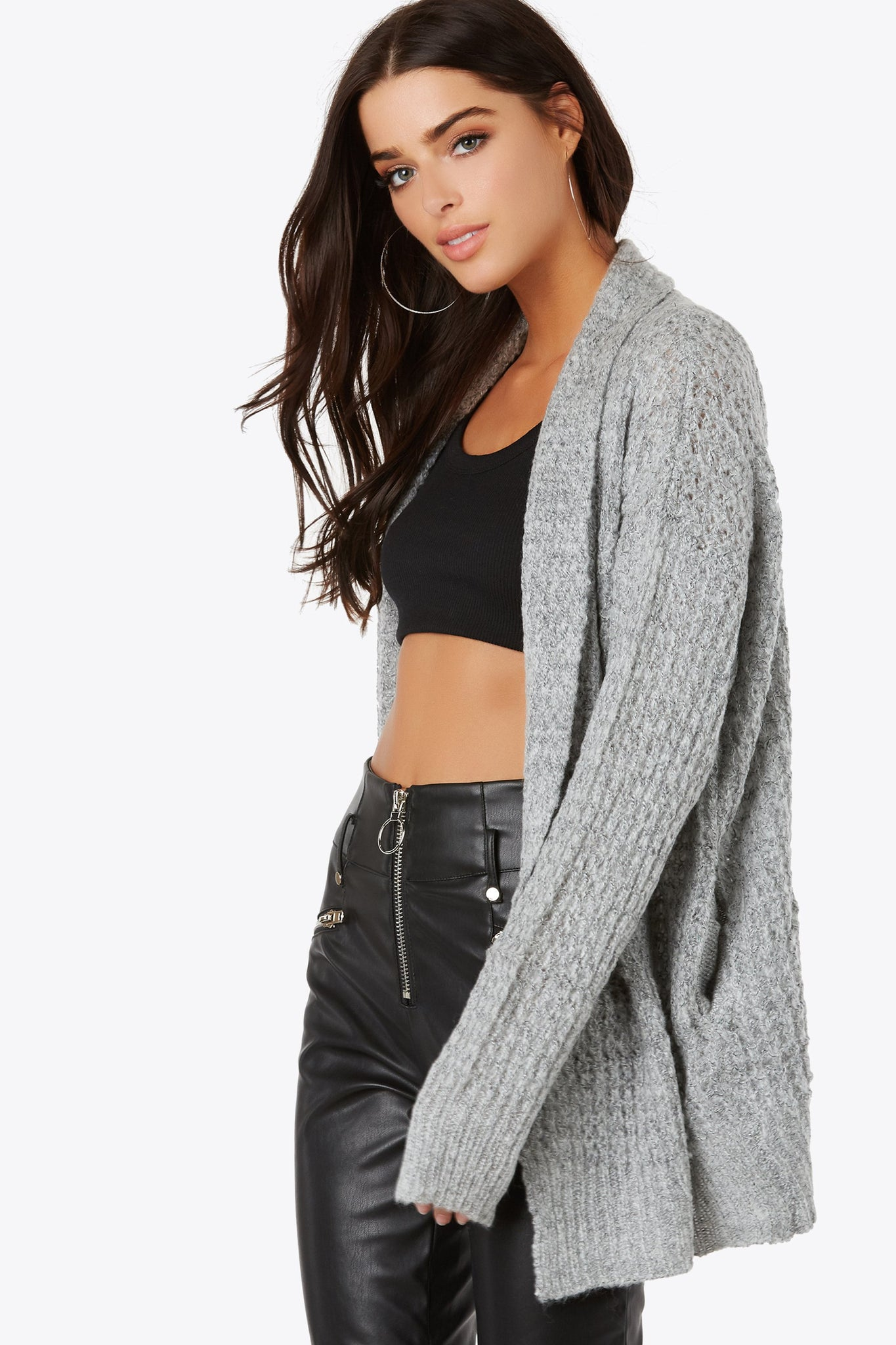 Throw this knitted cardigan over any outfit. Features front hidden pockets and rib knit trim.