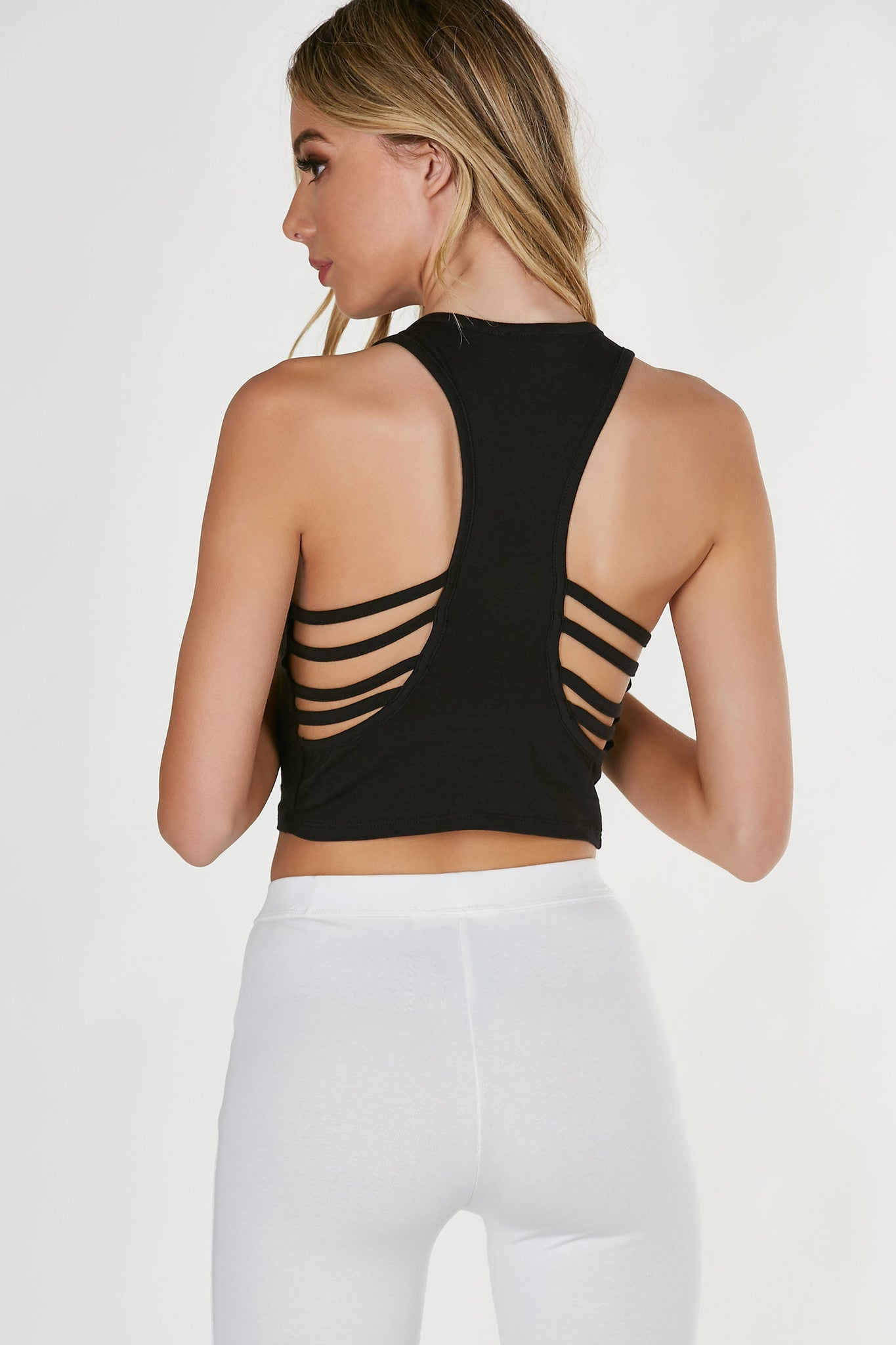 Sleeveless cropped tank with racerback and caged detailing. Form-fitting with straight hem all around.