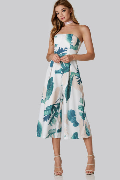 Chic strapless tube jumpsuit with bright tropical print throughout. Elasticized back with wide leg fit.